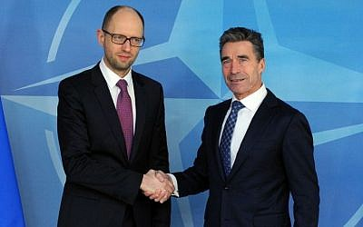 Ukraine's Prime Minister Arseniy Yatsenyuk, left, shakes hands with NATO Secretary General Anders Fogh Rasmussen prior to a meeting at NATO headquarters in Brussels, March 6, 2014 (Photo credit: Eric Vidal/AP)