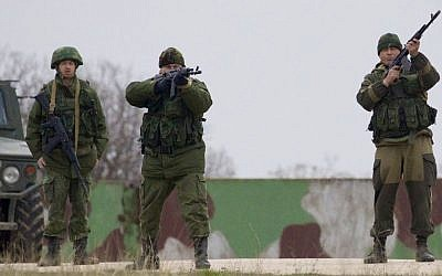 Russian soldiers fire warning shots at the Belbek air base, outside Sevastopol, Ukraine, on Tuesday, March 4, 2014. (photo credit: AP/Ivan Sekretarev)