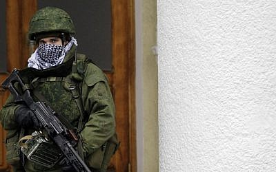 An unidentified soldier patrols in front of the airport in the city of Simferopol in Crimea, Ukraine, February 28, 2014. (AP/Darko Vojinovic)