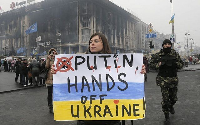 A woman holds a poster against war at Kiev's Independence Square, in Ukraine, Thursday, March 6, 2014.  (photo credit: AP/Efrem Lukatsky)