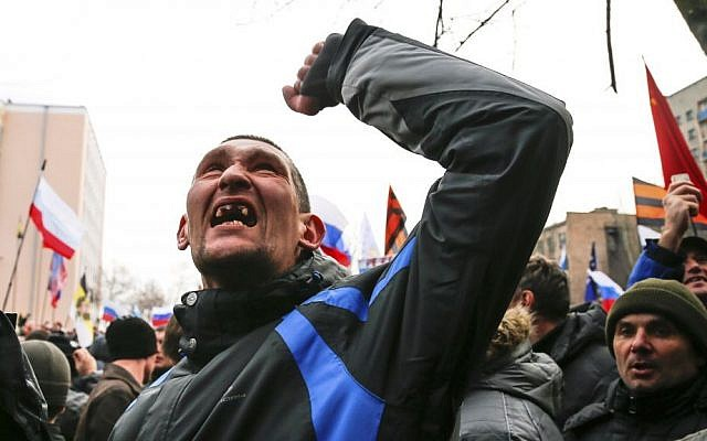 A pro-Russia demonstrator gestures in Ukraine on Sunday, March 16, 2014. (photo credit: AP Photo/Andrey Basevich)