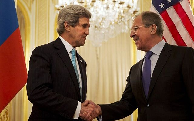 US Secretary of State John Kerry, left, shakes hands with Russian Foreign Minister Sergey Lavrov before the start of their meeting at the Russian Ambassador's residence about the situation in Ukraine, in Paris Sunday March 30, 2014.  (photo credit: AP/Jacquelyn Martin, Pool)