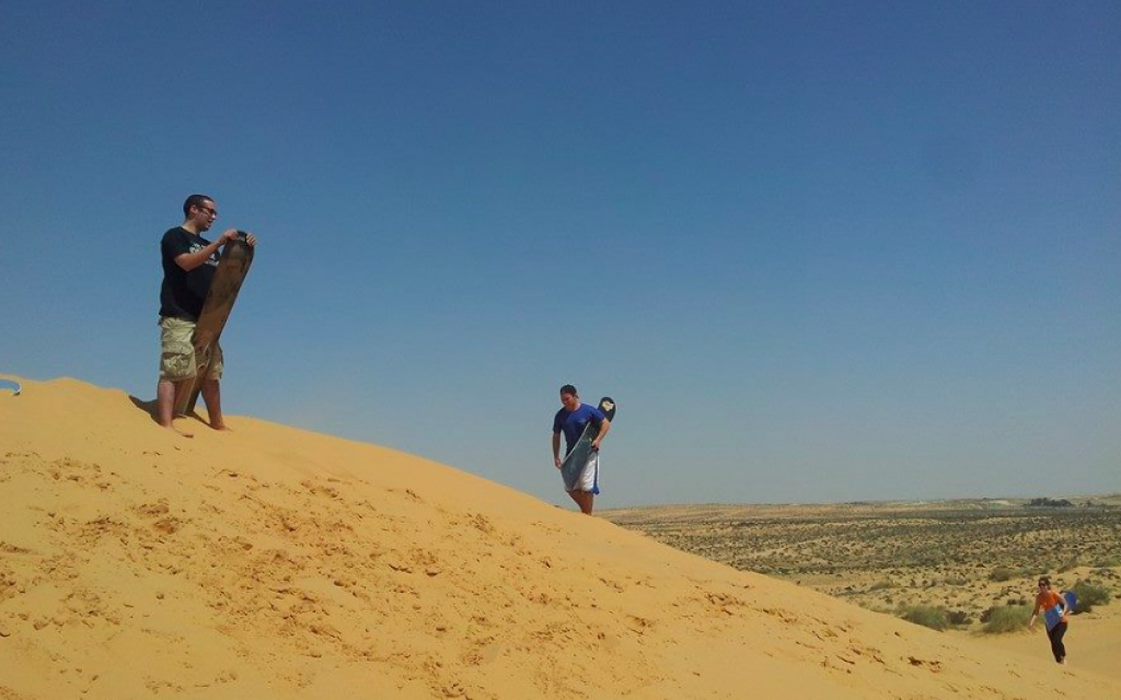 Sandboarding on the dunes (photo credit: Dror BaMidbar)