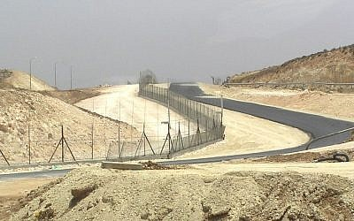 Illustrative: A section of the security fence near Hebron (Wikipedia)