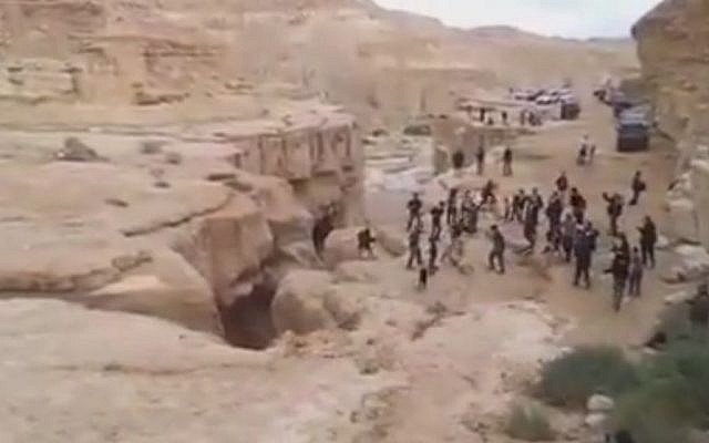 Spectators scurry out of the path of the Negev's Zin River as it roars to life (screen capture: YouTube)