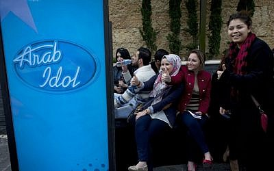"Palestinian youths wait for their turn to compete in the Arab world's premier talent show ""Arab Idol,"" at the luxury Grand Park Hotel, in the West Bank city of Ramallah, Monday, March 17, 2014. (AP Photo/Nasser Nasser)"
