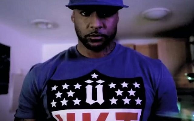 French rapper Booba, here in the music video for his song Parlons Peu. (screen capture, YouTube)
