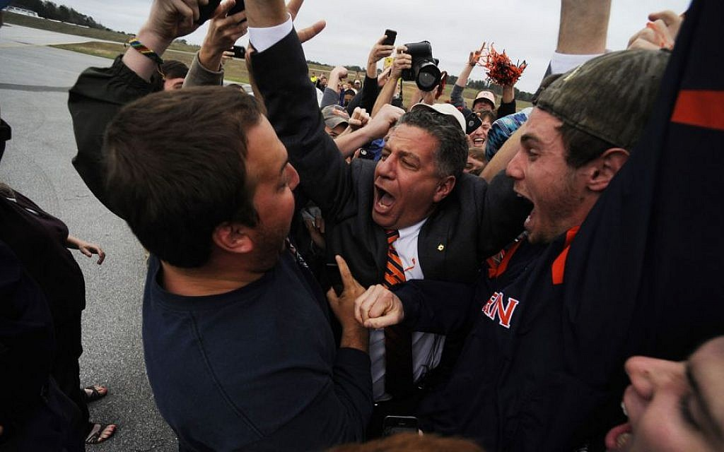 New Auburn basketball coach Bruce Pearl engulfed by adoring fans upon arriving at the Auburn University Regional Airport on his 54th birthday, March 18, 2014. (Courtesy Auburn University/Zach Bland/JTA)