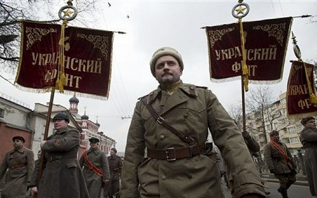 Pro-Kremlin demonstrators dressed in WWII army uniforms and carrying replicas of Soviet Army WWII banners reading, Ukrainian Front, march in central Moscow, Russia, Sunday, March 2, 2014 (photo credit: AP/Pavel Golovkin)