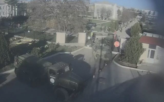 A Russian APC smashes open the gate of the Belbek air force base in Crimea, in footage taken from a security camera outside the base (Photo credit: Youtube screen capture)