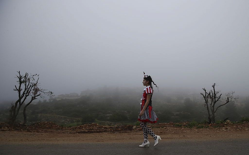 Walking through a foggy morning in costume (photo credit: Nati Shohat/Flash 90)