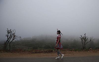 Walking through a foggy morning in costume (photo credit: Nati Shohat/Flash 90)