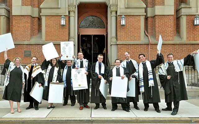 Illustrative: Newly ordained rabbis from Hebrew Union College's class of 2013 in Cincinnati celebrate with their ordination certificates outside the historic Plum Street Temple. (Janine Spang/JTA)