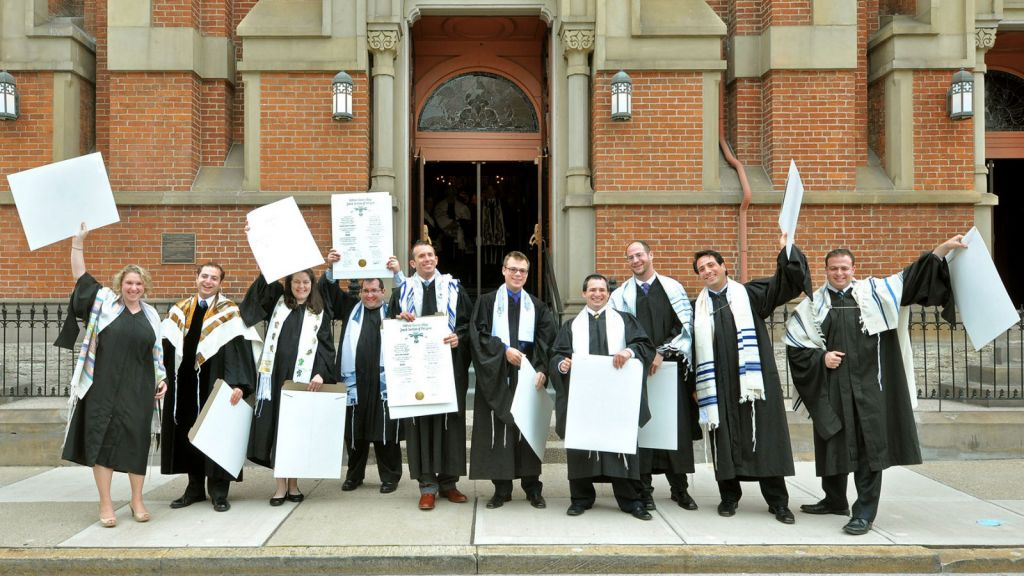 Newly ordained rabbis from Hebrew Union College's class of 2013 in Cincinnati celebrate with their ordination certificates outside the historic Plum Street Temple. (Janine Spang/JTA)
