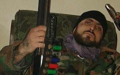 Wino Ayee Peeyakan, dressed in military uniform, brandishes two guns (photo credit: Nerses Kilajyan Facebook profile)