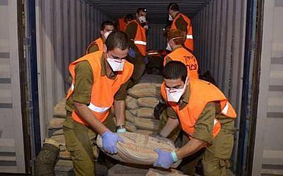 Israeli soldiers unload cargo found on the Klos-C. (photo credit: IDF Spokesperson)