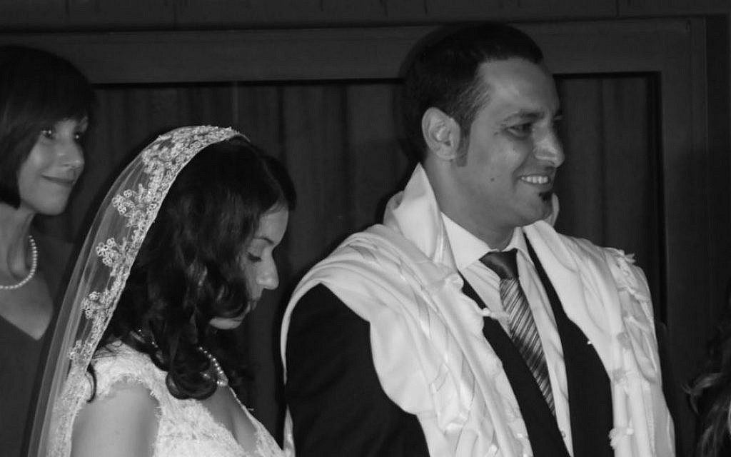 The Rabbinical Council of America's refusal to vouch for the validity of Karen Brunwasser's conversion to Judaism nearly derailed her Aug. 29, 2013 wedding in Israel to Lior Shabo. (Yoram Amir/JTA)