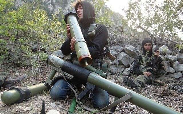 A rebel fighter checks a launcher near the village of Kasab and the border crossing with Turkey, in the northwestern province of Latakia, on March 24, 2014. (file photo credit: AFP PHOTO/AMR RADWAN AL-HOMSI)
