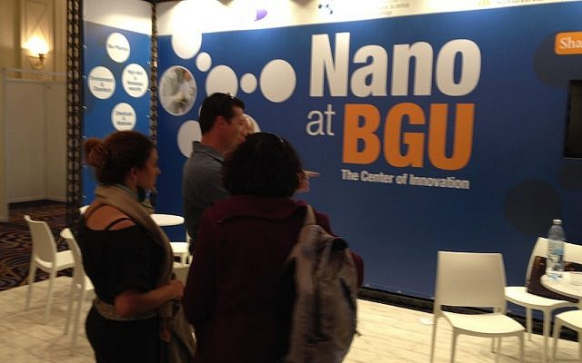Visitors discuss nanotechnology at the Ben Gurion University booth at NanoIsrael 2014 (Photo credit: Courtesy)