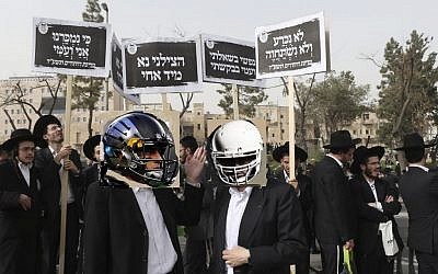 Ultra-Orthodox men protesting the NFL draft in Jerusalem on Sunday. (photo illustration: Nati Shohat/FLASH90)