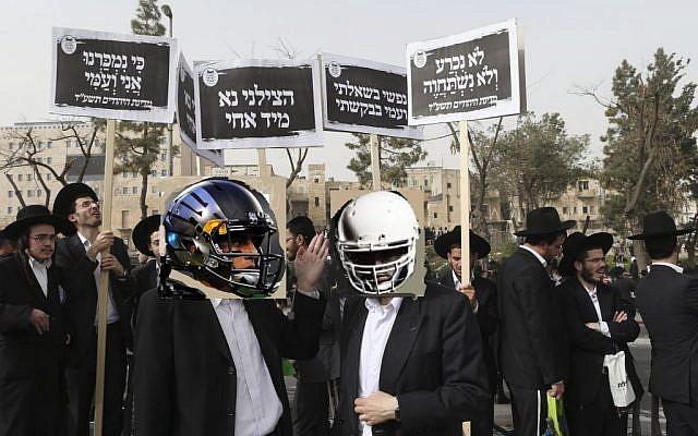 Ultra-Orthodox men protesting the NFL draft in Jerusalem on Sunday. (photo illustration: Nati Shohat/FLASH90)