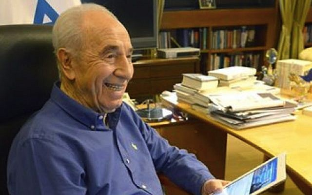 Equipped with an iPad, then-president Shimon Peres prepares to answer questions posed to him on Facebook, March 2014. (Photo credit: Courtesy)