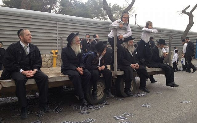 A group of ultra-Orthodox men and boys wait for the rally to start (photo credit: Mitch Ginsburg/Times of Israel)