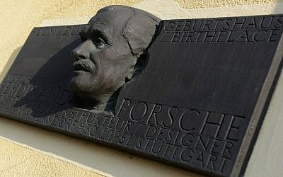 A memorial plaque displays a sculpture featuring Ferdinand Porsche, German automotive engineer and founder of the Porsche car company, on his family house in his native village of Vratislavice near Liberec on February 27, 2014. (photo credit: AFP Photo/Michal Cizek)