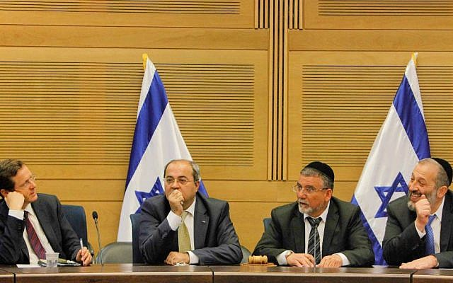 MK Aryeh Deri (R), MK Ahmad Tibi (2L), Labor Party head MK Isaac Herzog (L) and MK Yitzhak Vaknin at a meeting of the opposition at the Knesset, March 11, 2014 (photo credit: Miriam Alster/Flash90)