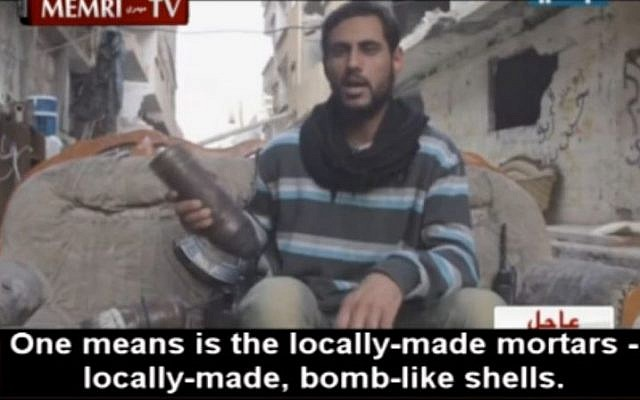 Former Syrian shotput champion, now bomb-thrower, Abu Al-Kazem (photo credit: MEMRI screenshot)
