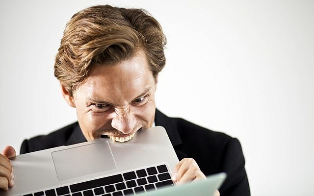 A frustrated reader of the Onion (laptop image via Shutterstock)