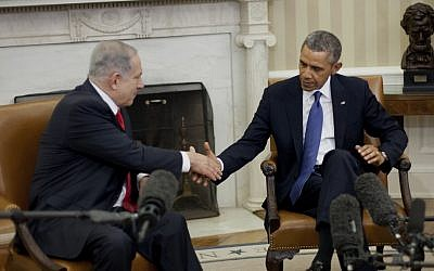 US President Barack Obama and Prime Minister Benjamin Netanyahu shake hands during their March 3, 2014, meeting in the Oval Office of the White House in Washington. (AP/Pablo Martinez Monsivais)