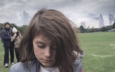 A screenshot from a video by Save The Children UK· showing a young British girl enduring circumstances similar to those endured by Syrian children in the course of one year. (screen capture, YouTube)