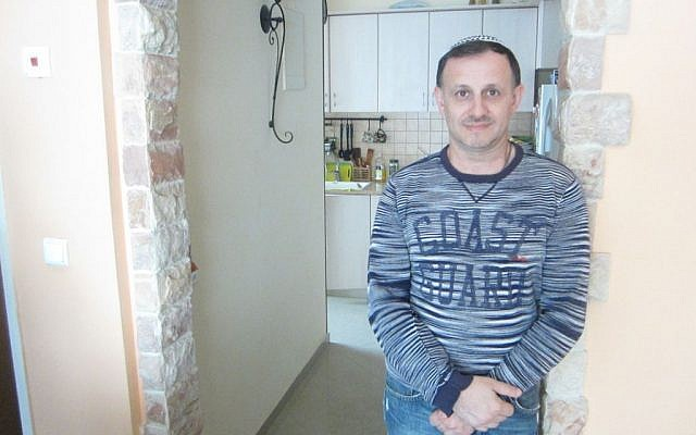 Yuriy Yukhatskov has been trying to immigrate to Israel for three years, but has been denied due to what he says is an error he made filling out a form. (photo credit: Ben Sales/JTA)