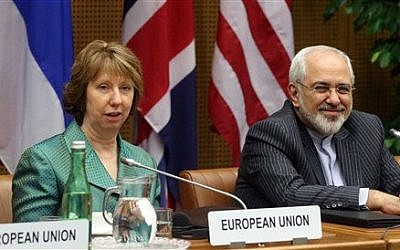 European Union foreign policy chief Catherine Ashton, left, and Iranian Foreign Minister Mohamad Javad Zarif, right, wait for the start of closed-door nuclear talks in Vienna, Tuesday, March 18, 2014 (photo credit: AP/Ronald Zak)