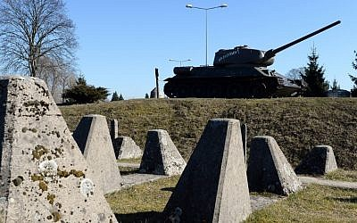 A Russian T-34 tank from WWII is pictured at the Festungsfront Oder-Warthe-Bogen (Fortified Front Oder-Warthe-Bogen), also called Ostwall (East Wall) fortification, the former Nazi German defence line near the city of Miedzyrzecz in western Poland, on March 13, 2014 (photo credit: AFP/JANEK SKARZYNSKI)