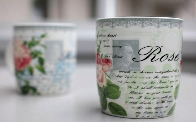 Two coffee mugs featuring a picture of a stamp with Adolf Hitler's portrait on it can be seen in Herford, western Germany on April 11, 2014. (photo credit: AFP PHOTO / DPA / OLIVER KRATO0)