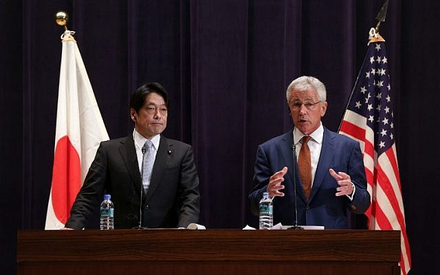 US Secretary of Defense Chuck Hagel (R) and Japanese Defense Minister Itsunori Onodera participate in a joint news conference at the Japanese Ministry of Defense headquarters in Tokyo on Sunday, April 6, 2014 (photo credit: AFP/POOL)