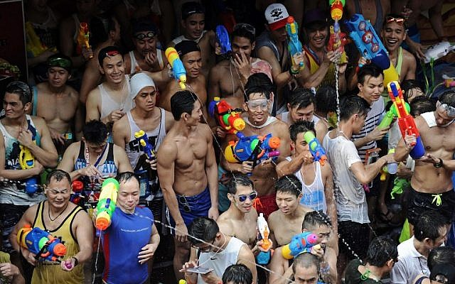 People take part in water battles in Bangkok as they celebrate Songkran, the festival that marks Thailand's New Year, on April 13, 2014. (photo credit: AFP/Christophe Archambault)