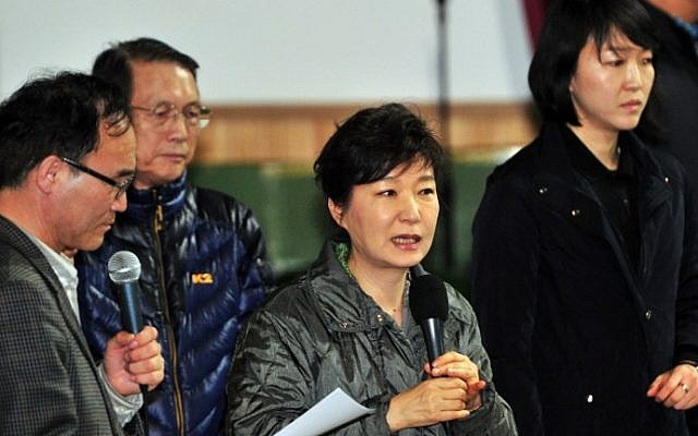 South Korea's President Park Geun-Hye (C) speaks during a visit to relatives of missing passengers on board a capsized ferry as they wait for updates about their loved ones at a gym in Jindo on April 17, 2014. (Jung Yeon-Je/AFP)
