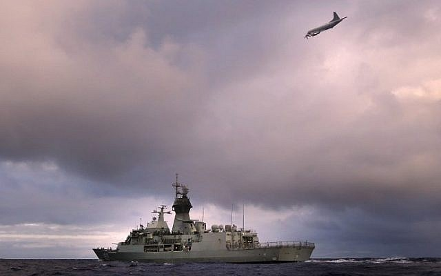 Ships and planes search for debris from missing Malaysia Airlines flight MH 370 in the southern Indian Ocean in April 2014. (Abis Nicolas Gonzalez/Australian Defence/AFP)