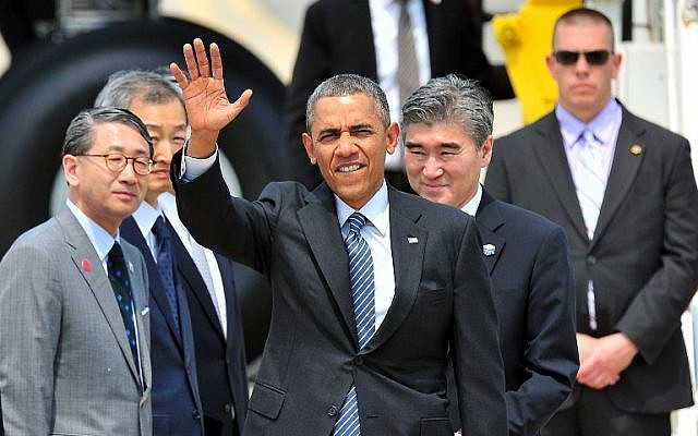 US President Barack Obama waves to the media as he arrives at Osan Airbase in Pyeongtaek, south of Seoul, on Friday, April 25, 2014. (photo credit: AFP/Jung Yeon-Je)