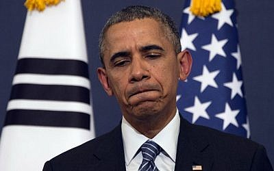 US President Barack Obama reacts to a question during a press conference at the Blue House in Seoul on Friday, April 25, 2014. (photo credit: AFP/Jim Watson)
