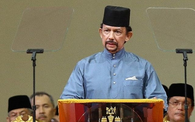 Brunei's Sultan Hassanal Bolkiah delivers a speech during the official ceremony of the implementation of Sharia Law in Bandar Seri Begawan on April 30, 2014. (photo credit: AFP)