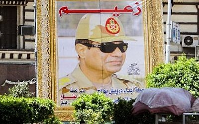 A poster bearing a portrait of retired army chief and presidential candidate Abdel Fattah al-Sissi on April 12, 2014 in the capital Cairo.  (photo credit: AFP photo/Mohamed el-Shahed)