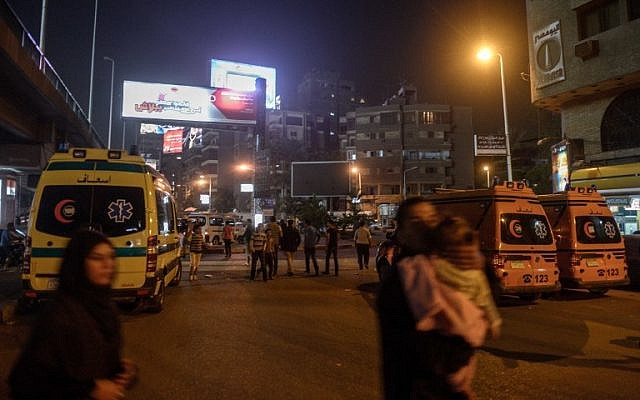 Egyptian ambulances gather at at site of an explosion targeting a traffic police kiosk in Cairo early on Saturday, April 19, 2014 (photo credit: AFP/Mohamed el-Shahed)
