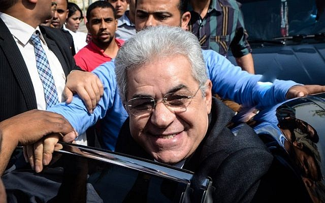 Egyptian leftist leader Hamdeen Sabbahi arrives to submit the documents required to run in the presidential election to the High Presidential Elections Committee on April 19, 2014 in Cairo. Hamdeen Sabbahi, who presented 31,100 electoral endorsements, is seen as the main rival to former army chief Abdel Fattah el-Sissi who is widely expected to win the May 26-27 election. (photo credit: AFP/MOHAMED EL-SHAHED)