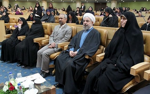A handout picture released on April 20, 2014 by the official website of the Iranian president show Iranian President Hassan Rowhani (2ndR) listening during a forum attended by members of Iran's female elite to mark Women's Day in Iran. (photo credit: AFP Photo/HO/Iranian Presidency)