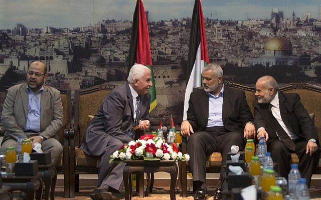 Hamas and Fatah officials discuss reconciliation in Gaza, Tuesday, April 22, 2014 (photo credit: AFP/Mahmud Hams)