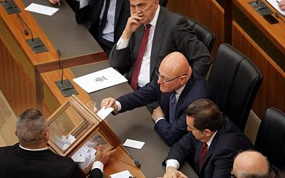Lebanese Prime Minister Tammam Salam (C) casts his vote to elect the new Lebanese president in the parliament building in downtown Beirut on April 23, 2014. (photo credit: AFP PHOTO/JOSEPH EID/POOL)